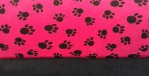 cerise black pawprints fabric